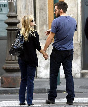 jake gyllenhaal and reese witherspoon. The story was Jake got down on
